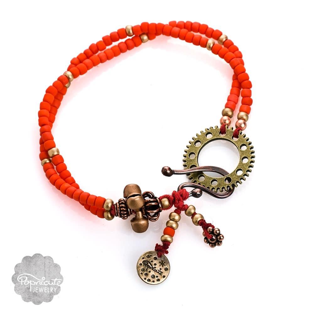 Locket Charm Bracelet: Orange Boho Steampunk Charm Bracelet