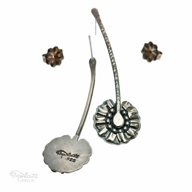 Sterling silver daisy earrings by Popnicute Jewelry.