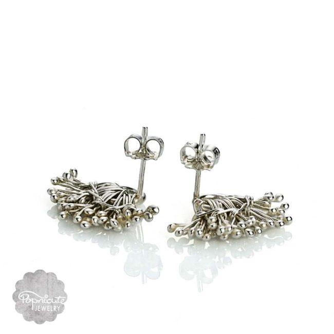 Silver dandelion ear studs by Popnicute Jewelry