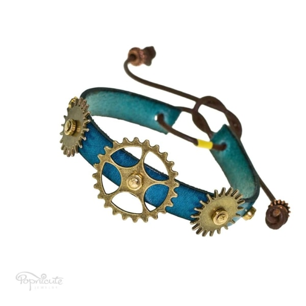 Steampunk bracelet. Teal blue leather band steampunk bracelet with gears and studs by Popnicute Jewelry. Unisex leather bands. Rock chic. Gift for rockers or bikers.