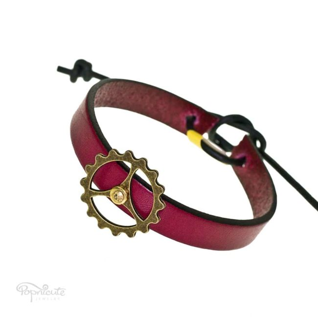 Burgundy steampunk bracelet. Burgundy red leather band steampunk bracelet with gears and studs by Popnicute Jewelry. Unisex leather bands. Rock chic. Gift for rockers or bikers.
