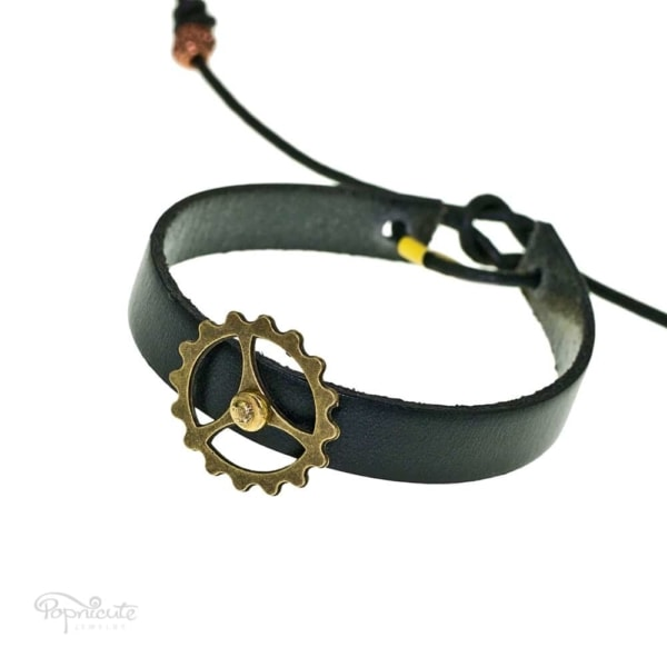 A rocking black gear bracelet made of genuine leather by Popnicute Jewelry. This steampunk-esq bracelet is fun for daily wear. Makes a great gift for a fashionable steampunk lover.