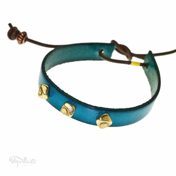 A fun teal blue studded bracelet made of genuine leather by Popnicute Jewelry. This bracelet is fun and simple for daily wear. Looks great stacked with other bracelets.