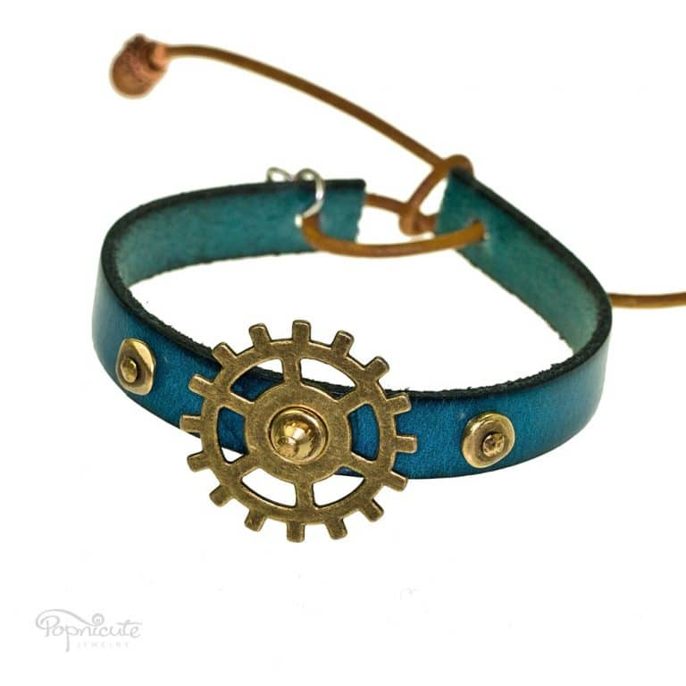 Fun filled teal fidget bracelet for the restless hand. A rocking studded bracelet made of genuine leather by Popnicute Jewelry. Teal blue leather band.