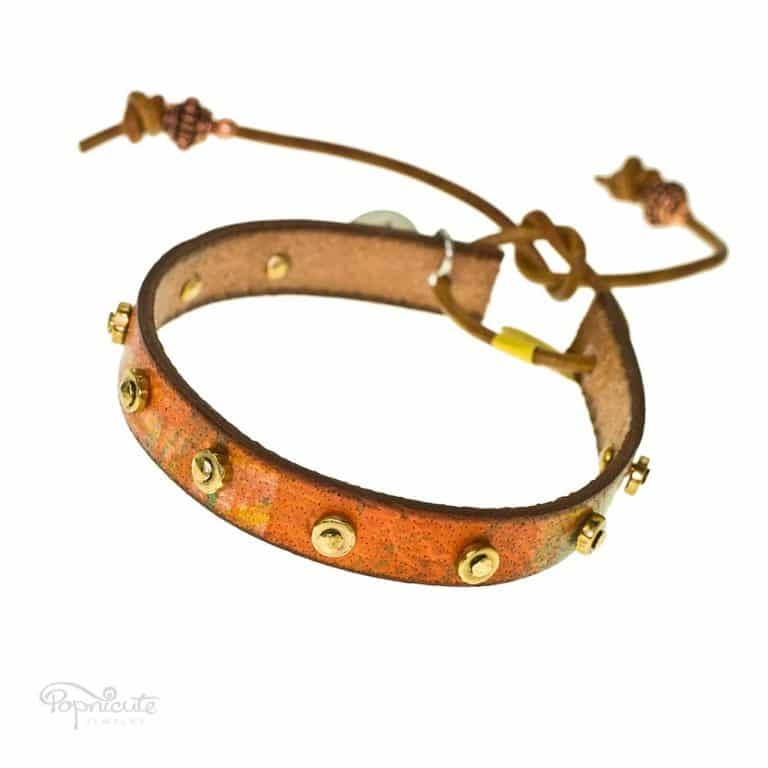 A simple but not understated studded all over bracelet made of genuine leather for your daily accessory. This studded bracelet is fun and colorful.