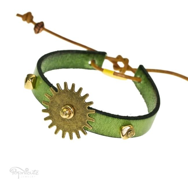 An attractive green steampunk bracelet made of green genuine leather and bronze gear by Popnicute Jewelry. This bracelet is fun and simple for daily wear. Looks great stacked with other bracelets.