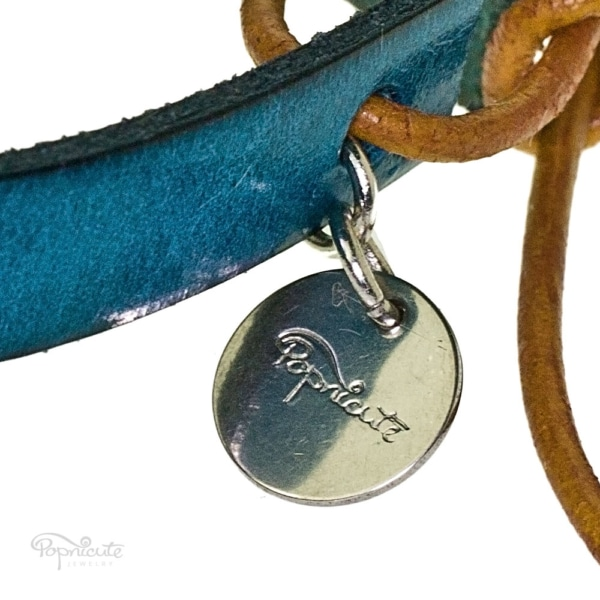 Popnicute Jewelry tag in stainless steel.