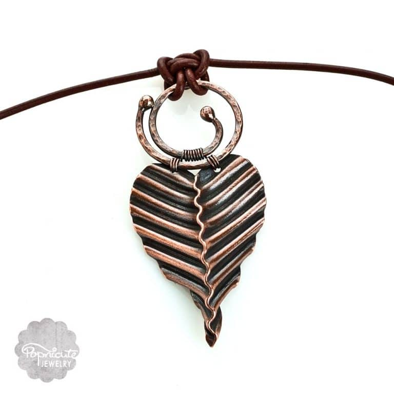 Copper heart pendant corrugated circle ring pendant by Popnicute Jewelry. Unique one of a kind necklace on leather cord.