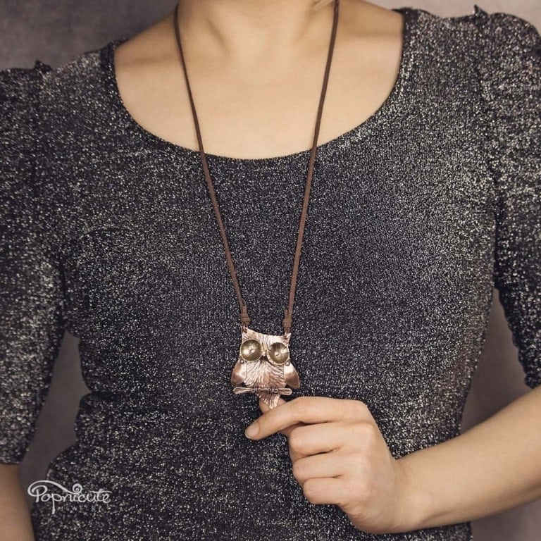 Popnicute Jewelry cute owl necklace in copper and brass. Wearable sculpture for your neck on model.