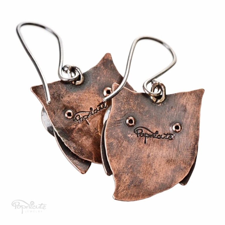 Whimsical owl earrings by Popnicute Jewelry. Small copper dangle earrings with argentium ear wires. Back side