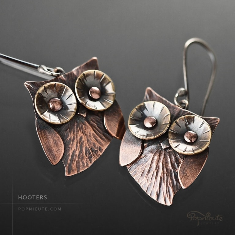 Whimsical owl earrings by Popnicute Jewelry. Small copper dangle earrings with argentium ear wires.