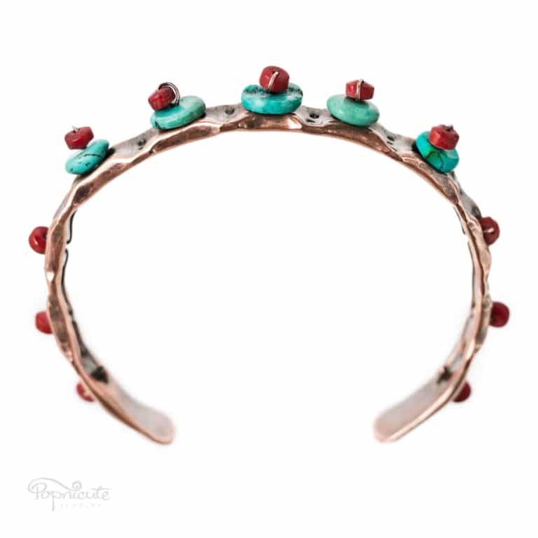 Turquoise and coral copper cuff bracelet. With a Southwestern inspired stone combination, this cuff bracelet is a charming addition to your daily jewelry.