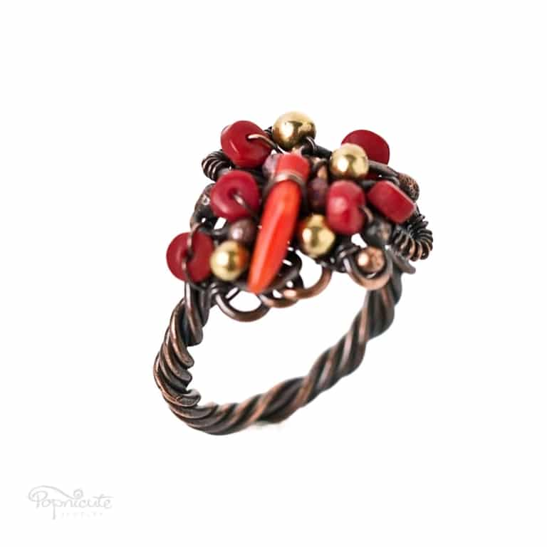 Cornucopia Wire Wrapped Coral Ring in Copper by Popnicute Jewelry size US 10.5. Side view.