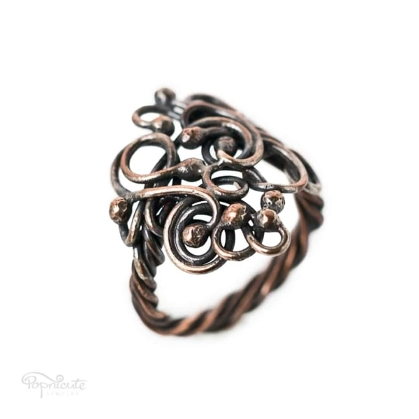 Tree of Life Wire Wrapped Thumb Ring in Copper and Brass by Popnicute Jewelry size 8.5. Side view