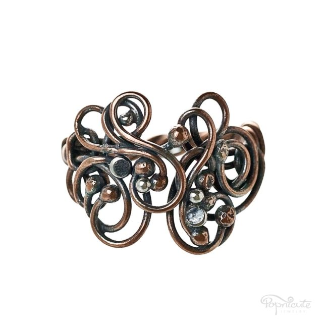 An adjustable arthritis ring for any of your finger. The design opens in the middle like a magic forest. Adjustable to size US 10 - 10.5. Arthritis friendly ring by Popnicute Jewelry.