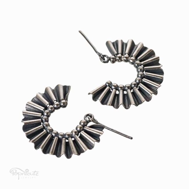 This fun semicircle fan earring design is made of sterling silver, handcrafted from scratch with unicorn tears. It dangles as you walk or shake your head.