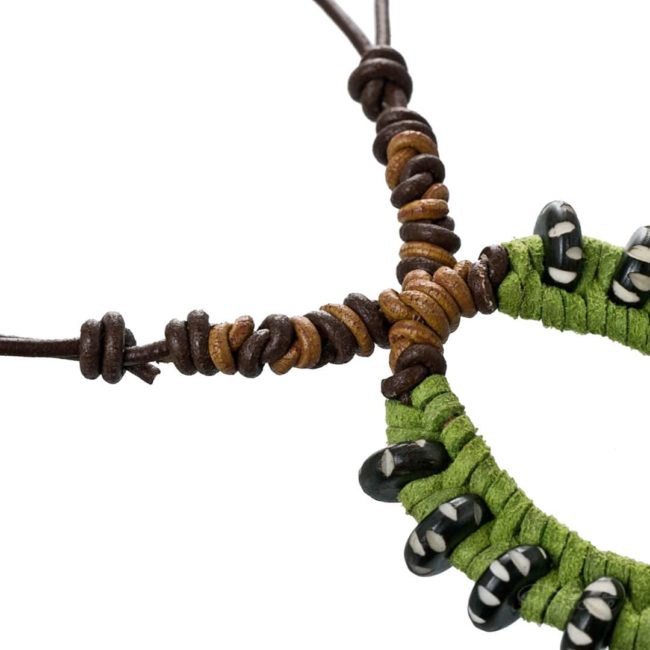 Imperial moth caterpillar necklace by Popnicute Jewelry. Leather knots close up.