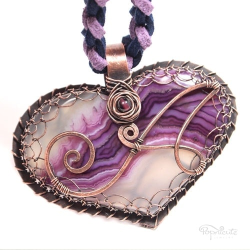 """""""Heart of Annelies"""" – Lies from Belgium chose a unique purple agate as the focal of her custom heart pendant with a decorative """"A"""" on the front."""