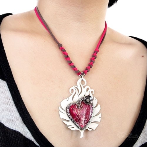 """""""Heart of Christiana"""" – Chrissy from Cyprus loved feathers and she asked for her custom heart pendant frame to be made into a feather with a skinnier border wrap."""