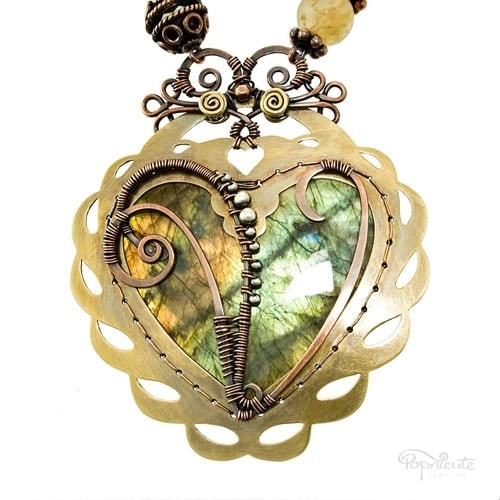 """""""Heart of Vesna"""" – Another Heart of Drew with a special crown and a """"V"""" initial for Vesna from USA. The custom frame hugs the most beautiful labradorite stone in duotone."""