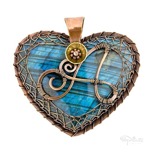 """""""Heart of Aarion"""" – A personalized heart pendant with an """"A"""" and a butterfly on top of a gorgeous blue labradorite with striation patterns."""