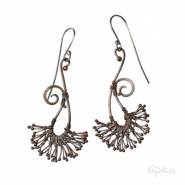 Dandier than the white puff dandelion seeds, these copper dandelion earrings surely will turn heads. They move with you. Swirly design. Handcrafted art jewelry.