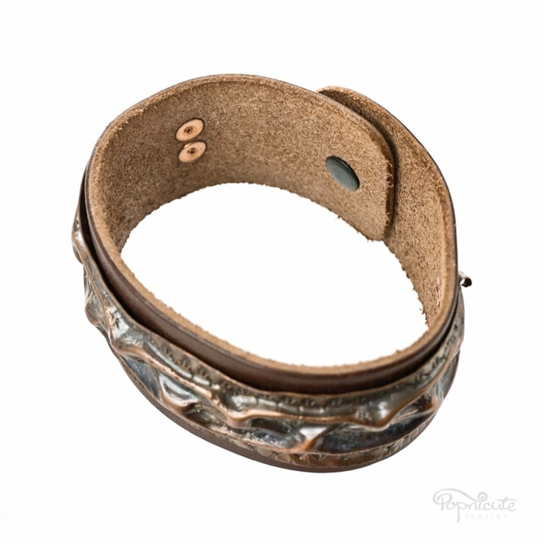 Heavily textured rustic copper and leather snap-on bracelet. Men's bracelet. Easy to wear with the snap-on clasp on the back. Riveted copper design with raised textures on top.