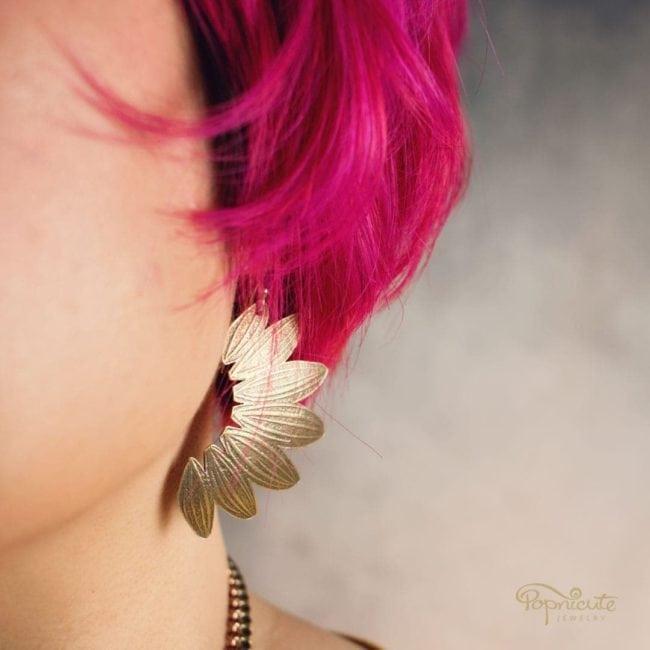 Sunflower earrings brass and silver by Popnicute Jewelry on model