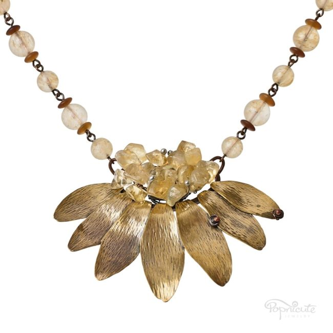4 in 1 sunflower necklace with a large yellow drusy citrine focal. A versatile necklace. Long, short, layered, it has it all! An artistic rendition of sunflower petals made of red brass.